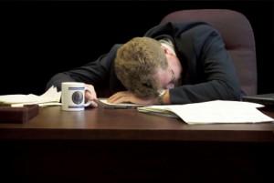 man-with-head-on-desk-300x201